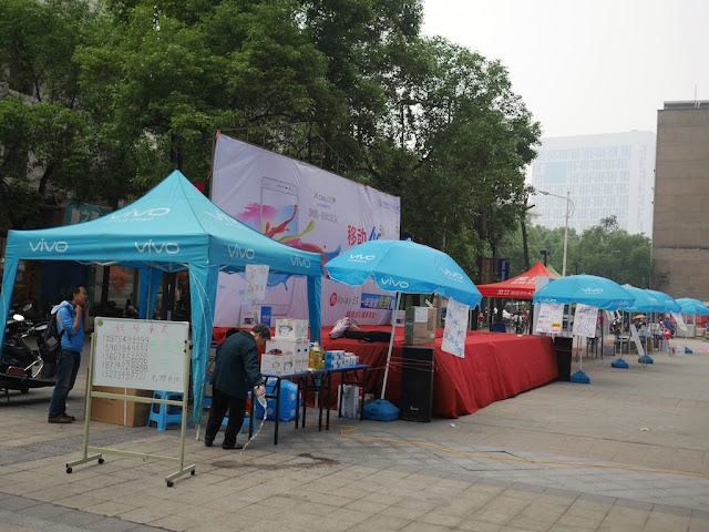 tents and umbrellas for an outdoor Vivo promotion in Hengyang, Hunan