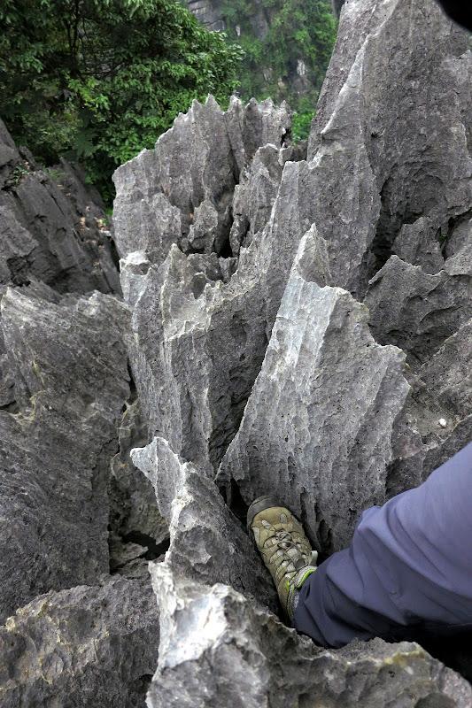 Our feet in sharp rocks