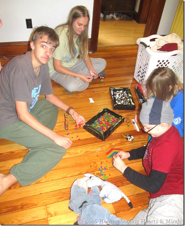 Kids building with Pinblocks at Homeschooling Hearts & Minds