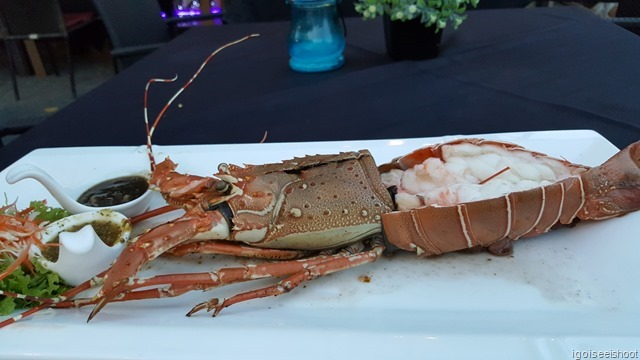 Grilled lobster, served with spicy, sweet and sour Thai seafood dipping sauce and a black pepper sauce.