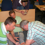 Casualty Care for Lifeboat Crew course – April 2011: crew member taking a history of the incident while other crew place an emergency care bandage over an open fracture