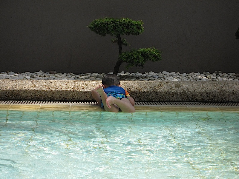 toddler getting up from pool