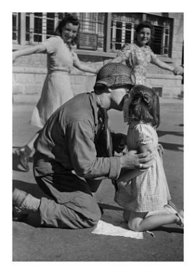 American soldier kissing a young girl in France after liberation, 1944