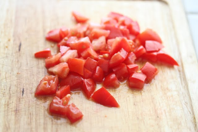 photo of diced tomatoes on a cutting board