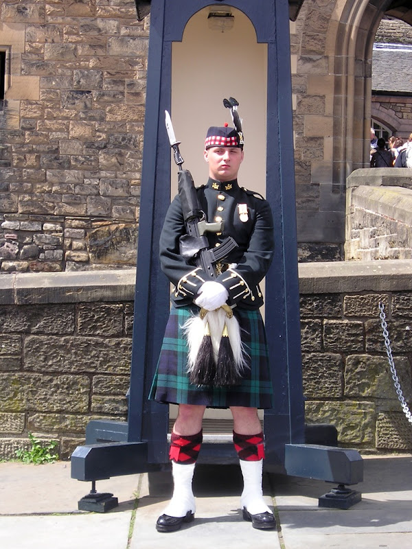 A Guard posted on the Esplanade outside the entrance to Edinburgh castle, during the week when the Queen is in residence in the Palace of Holyroodhouse
