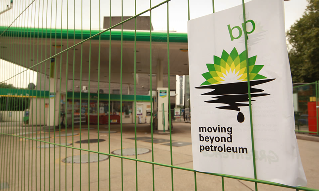 A BP gas station is tagged with a sign showing the 'BP - Beyond Petroleum' logo with an added oil spill. Photo: Peter Macdiarmid / Getty Images