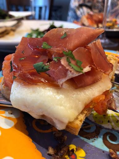 Montaditos : bread , tomato/ garlic , Serrano ham and Spanish cheese