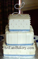 Three tier square white fondant unique modern stripe and pearls wedding cake with silver monogram and blue ribbons