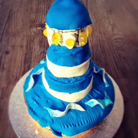 Blue and White Lighthouse Pinata Cake with Fairtrade Sugarpaste