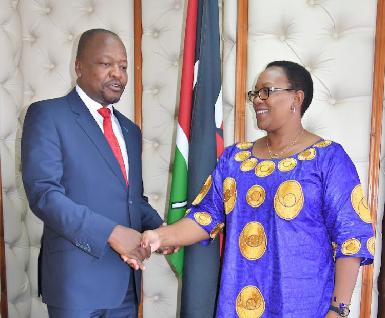 Health Cabinet Secretary Mutahi Kagwe and Sicily Kariuki, now the Cabinet Secretary for Water and Sanitation, during the handover on February 28.