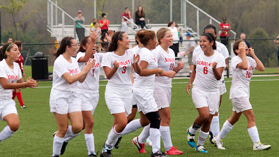 Ridgefield Park celebrating after Ridgefield Park # 11 Julie Rovito scored winnng goal.    Photos by TOM HART/  FREELANCE PHOTOGRAPHER.