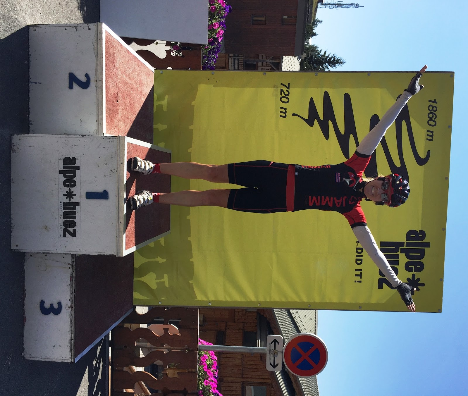 Cycling Alpe d'Huez - cyclist on the podium, PJAMM, Stacy Topping