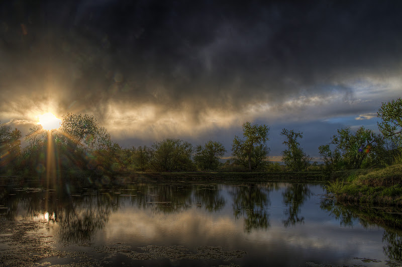 Sun-rays breaking through clouds at sawhill ponds