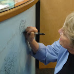 Lois Lowry signs the walls, next to other authors and illustrators of note