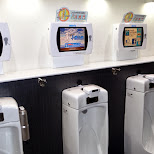 playing games while taking a piss in Odaiba, Tokyo, Japan