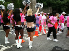 Atlanta Falcons cheerleaders cheering on the walkers as they head towards the starting line.