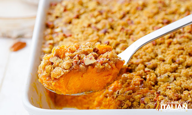 southern sweet potato casserole in pan being scooped