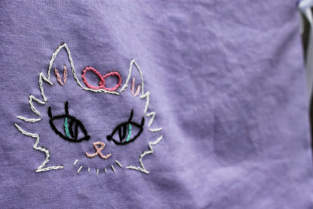 reversible wrap top with kitty embroidery