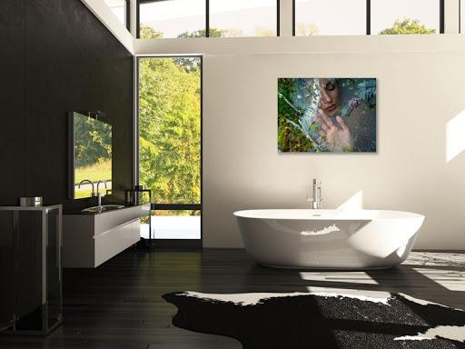 Photograph hangs above bathtub in large open bathroom