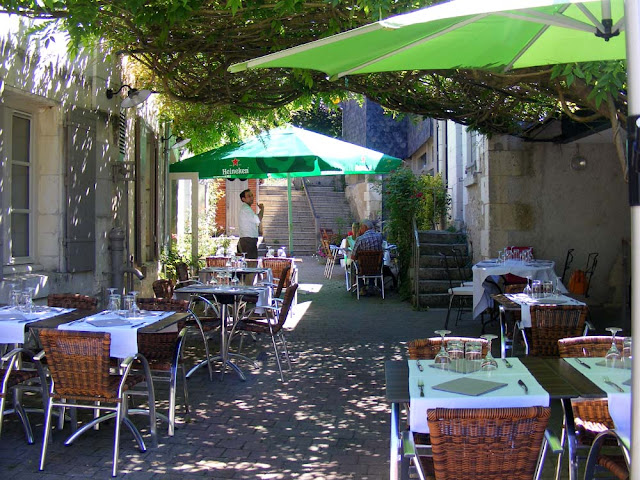 Wisteria covered restaurant terrace, Indre et Loire, France. Photo by Loire Valley Time Travel.