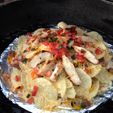 Nachos cooking on the grill.