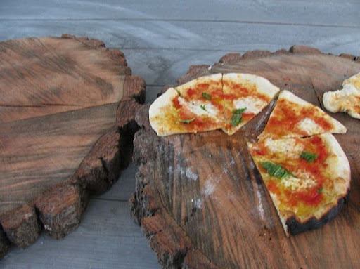 Pizza Margherita, on two-foot oak rounds, how's that for rustic serving? (Photo: Cheryl Bulpitt)