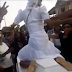 Agbako: Woman Shows twerking skills as She Twerks on top of a casket During Funeral Procession (Photos)