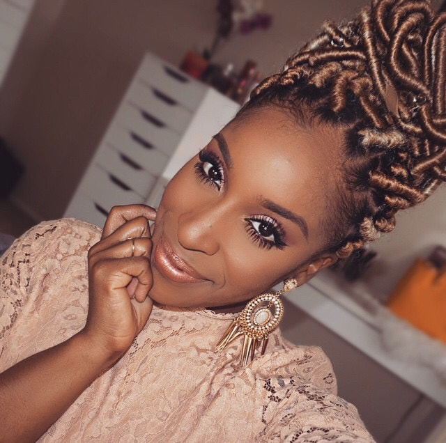 jackie aina with gold faux locs in her hair