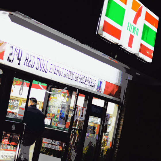 7-Eleven store front at night. photo/ps