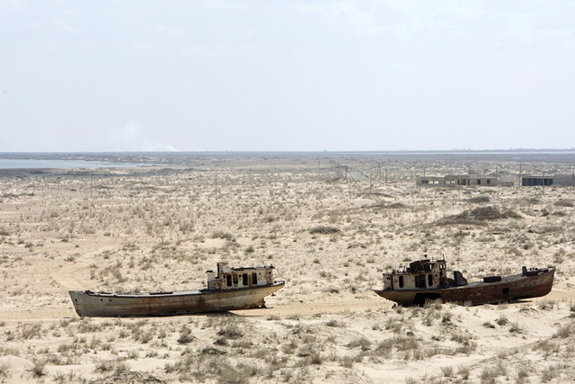 A view of rusted, abandoned ships in Muynak, Uzebkistan, a former port city whose population has declined precipitously with the rapid recession of the Aral Sea. Photo: Eskinder Debebe / UN Photo