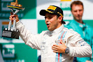 Felipe Massa on the podium with trophy