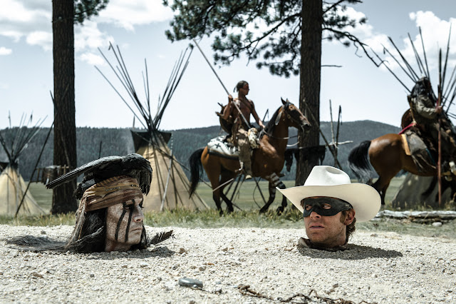 THE LONE RANGER Johnny Depp as Tonto and Armie Hammer as The Lone Ranger up to their necks in it