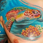 coral and turtle under the sea - tattoos for men