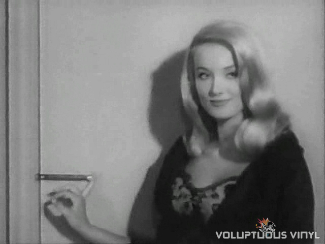 Barbara Bouchet locks the door.