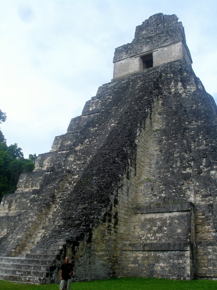 I'm tiny standing at the foot of the largest of Tikal's temples..