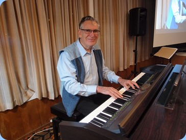 Roy Steen playing the arrival music on our Clavinova CVP-509. Photo courtesy of Dennis Lyons.