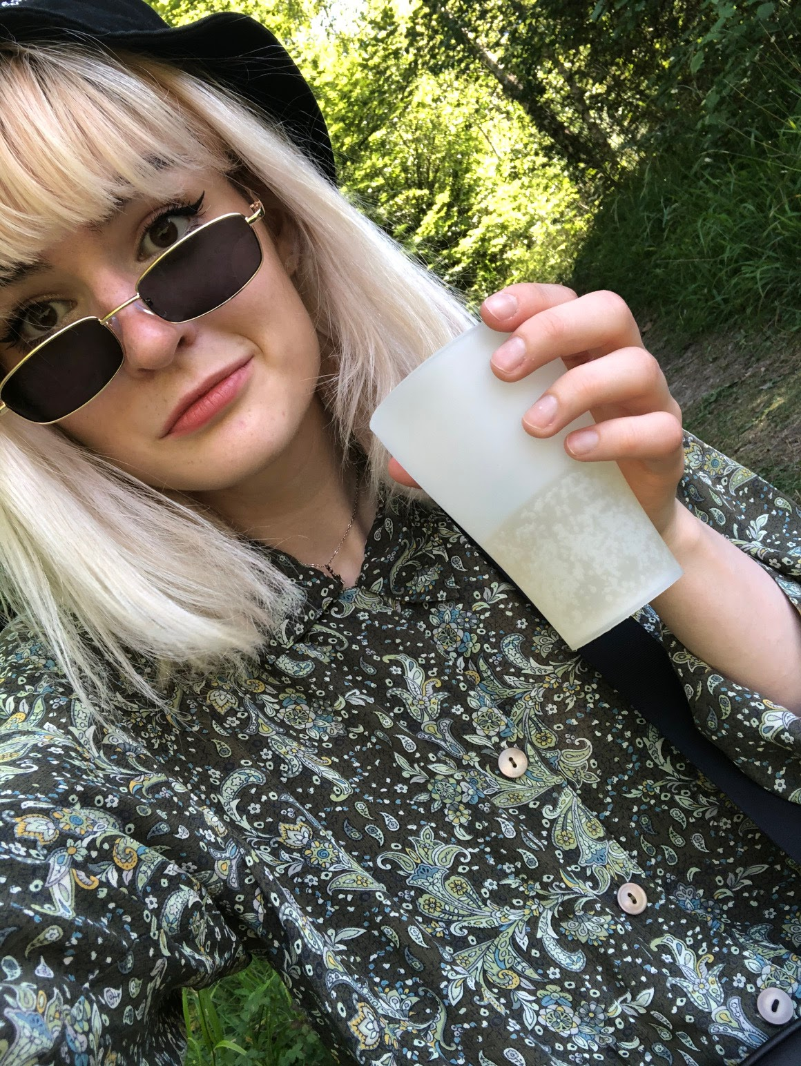 girl with bleached blonde hair, vintage shirt and bucket hat. The photo is of my bleached hair before applying champagne supertoner