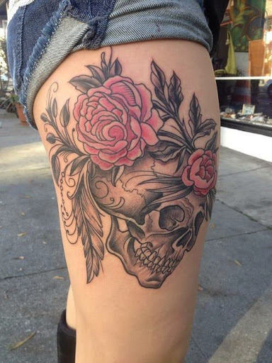 Flower skull thigh tattoo are