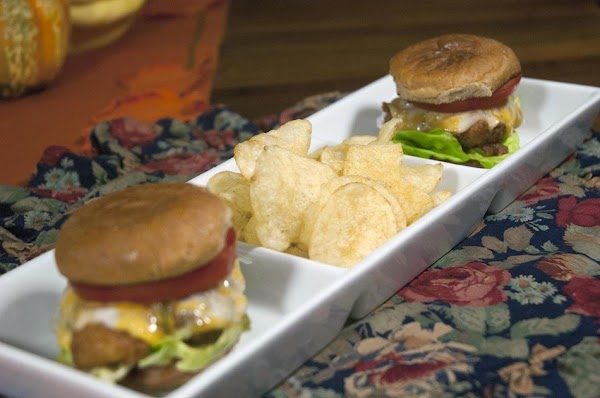 Top with a tomato slice, add the top bun and serve with your favorite...