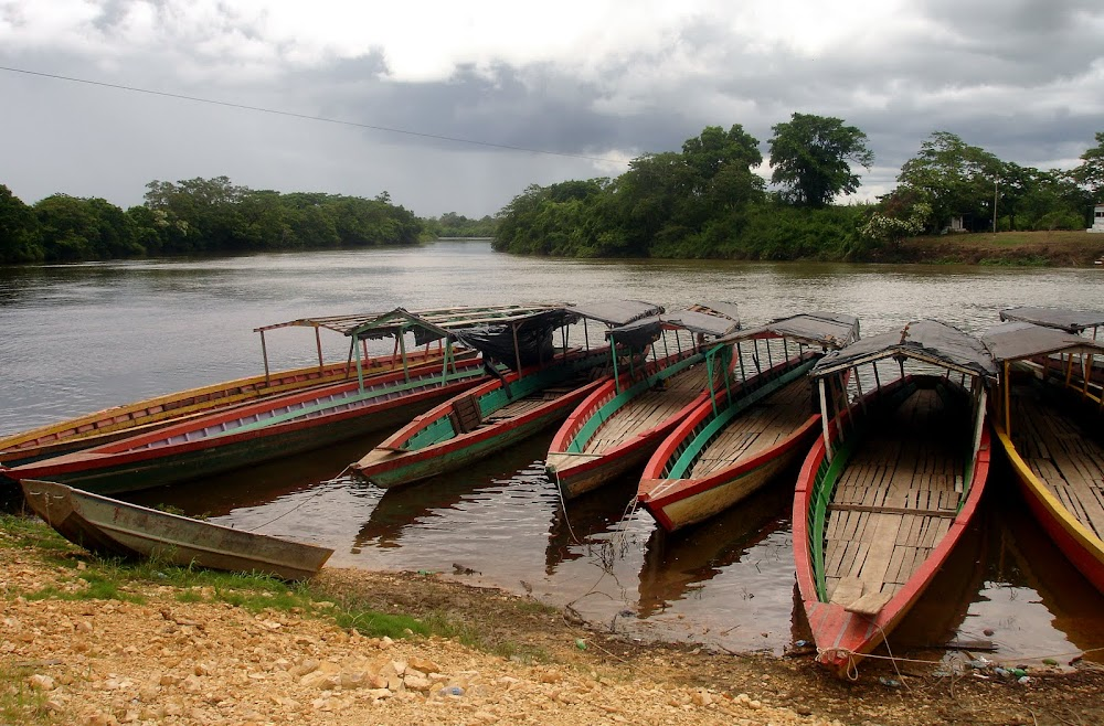 long boats lined along the river banks, their owners ready to negotiate rides to the nearby El Ceibal ruins...