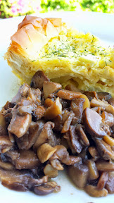 Balkan Cheese Pie - Burek recipe, here served with sauteed mushrooms in garlic butter. Burek is an easy layering of cheese egg mixture with phyllo dough, like a Mediterranean or Eastern European quiche