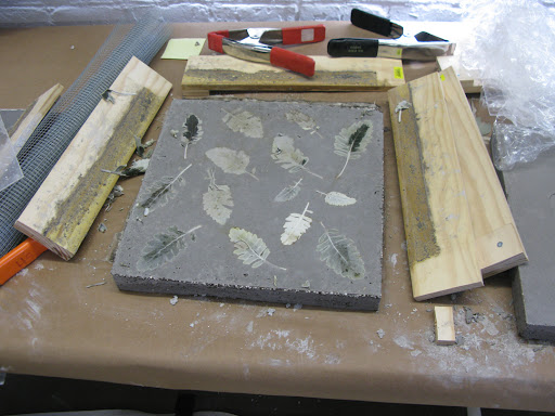 Table top slab with dusty miller embedded