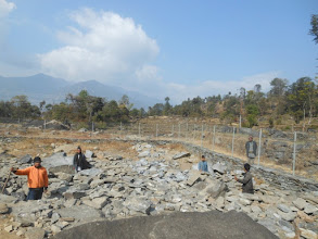 Photo: People standing in the dug spaces required for the pillars