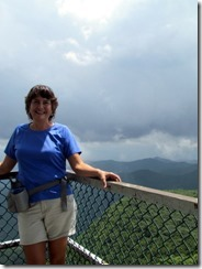 Tricia enjoys the views from the fire tower