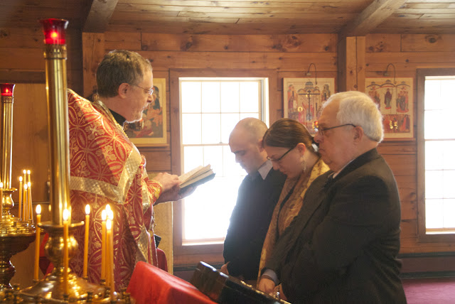 Fr. John reads the prayers for reception into the catechumenate.