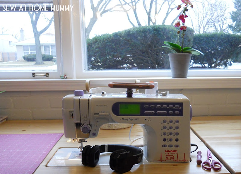 how to cheaply and easily mount your cell phone to your sewing machine to watch movies