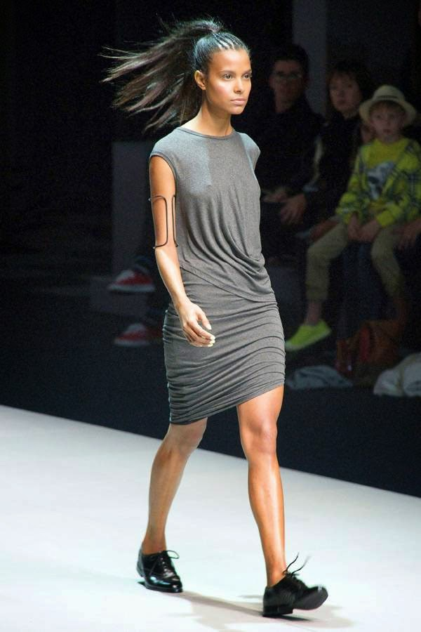 A model presents a creation by designer Cari Stephenson of Love Tart, on the second day of the Cape Town Fashion Week, on July 25, 2014, in Cape Town.