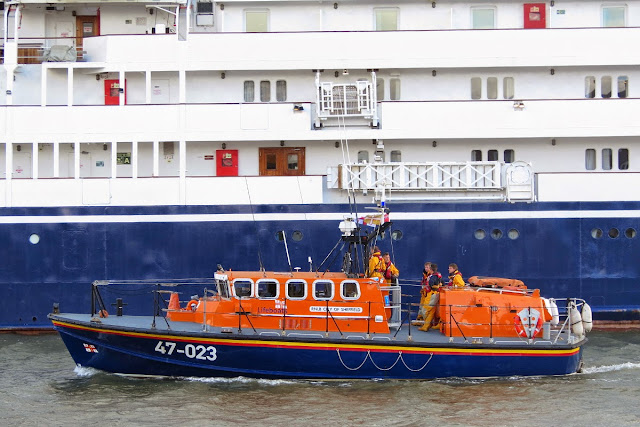 The all-weather lifeboat passes the passenger cruiser Corinthian as she's docked at the quay - 18 May 2015.  Photo credit: Kevin Mitchell, Maritime Images