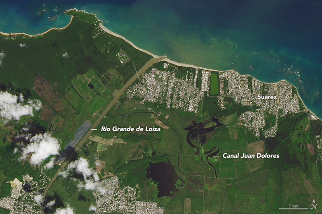 On 23 September 2017, the Operational Land Imager (OLI) on the Landsat 8 satellite captured this image of Puerto Rico before Hurricane Maria. This image shows the Rio Grande de Loíza, the island's largest river by volume, where it meets the Atlantic Ocean several miles east of San Juan and west of Suárez. Photo: Joshua Stevens / NASA Earth Observatory