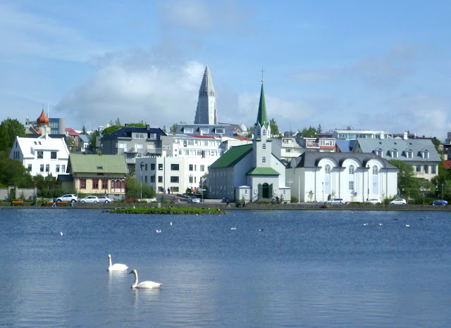 Church, swans and lake in Reykjavik